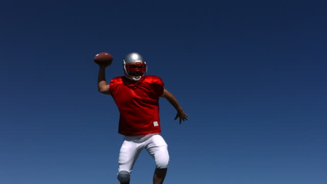 Football player jumps in air and passes ball  touchdown stock videos & royalty-free footage