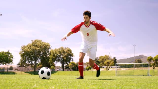 Football player kicking the ball video