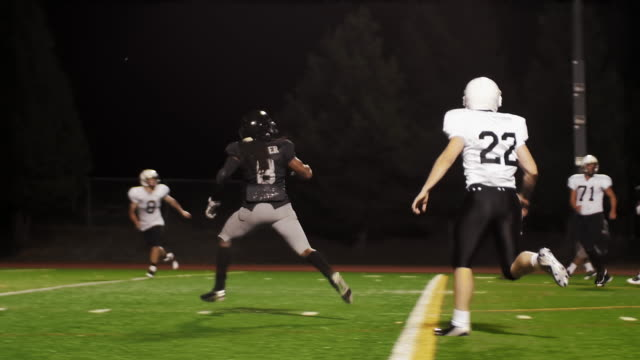 A football player makes a touchdown and celebrates with his teammates video