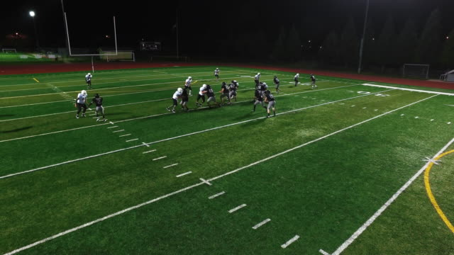 a football player makes a touchdown, view from above - football field stock videos & royalty-free footage