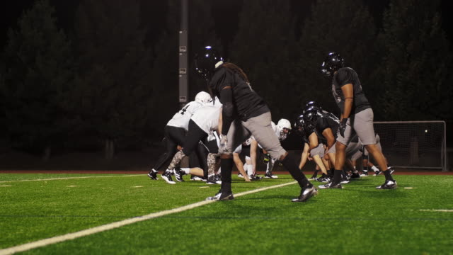 Football players blocking their opponents after the ball is snapped video