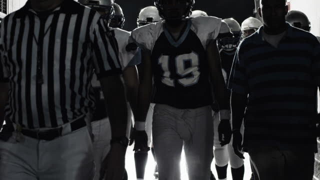 Football players come out of tunnel  touchdown stock videos & royalty-free footage