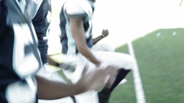 Football players warming up video
