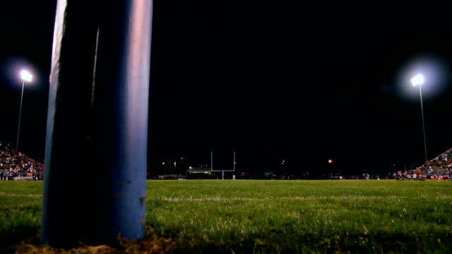 Football Stadium Nighttime Dolly Dolly of a crowded football field at night. goal post stock videos & royalty-free footage