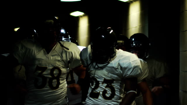 A football team gets pumped up walking down tunnel before a game video