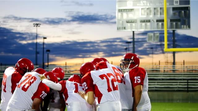 Football Team huddles together