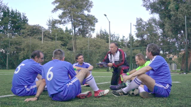 Football technician giving directions to his football team