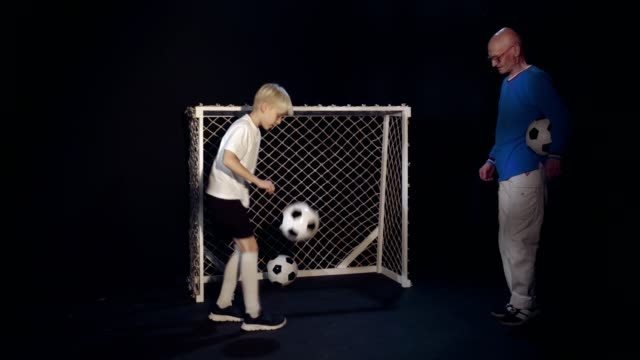 Footballer Boy Is Performing His Soccer Skills To Old Man video