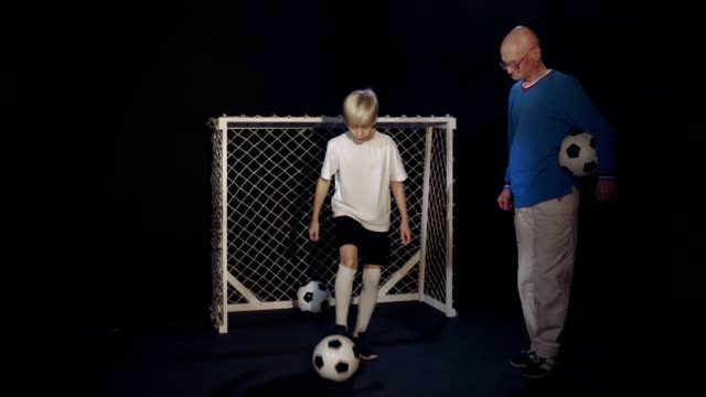 Footballer Grandson Is Showing Grandfather His Soccer Skills With Ball video