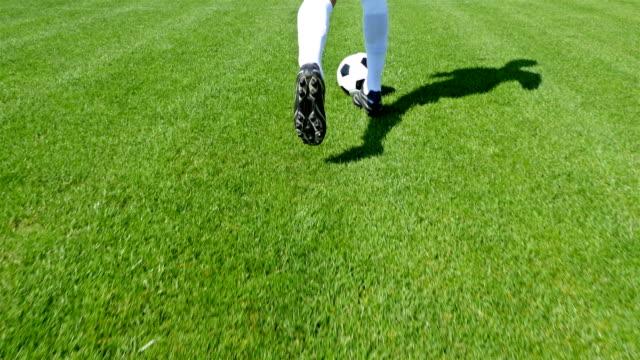 Footballer leading the ball on a football field video