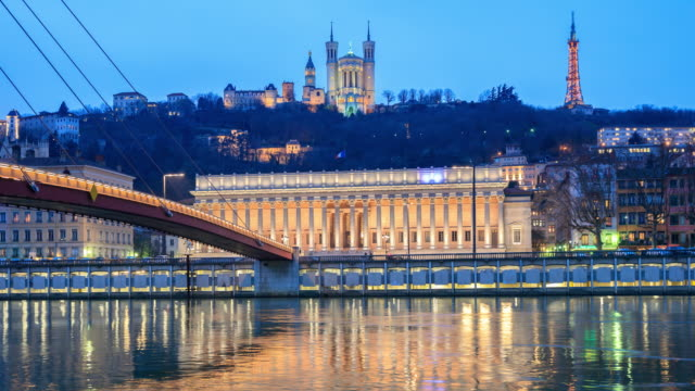 Footbridge, courthouse and basilica by night, Lyon, France.