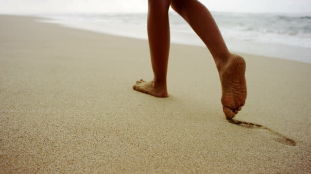 Footsteps in the soft sand video