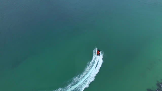 For fun just add water 4k drone footage of a speedboat traveling at sea western cape province stock videos & royalty-free footage