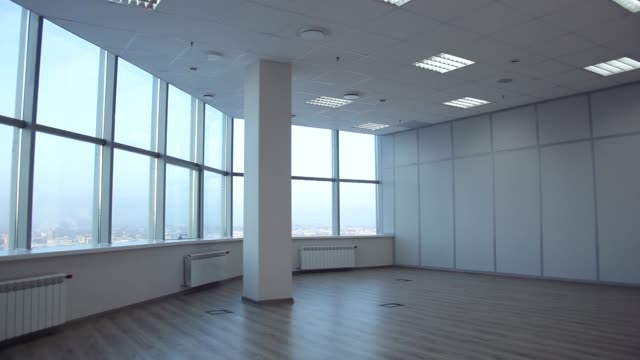 For Rent Large office space is leased. There is room for negotiation. On the windows we see jalousie. Space without walls with large windows. panoramic shot loft apartment stock videos & royalty-free footage