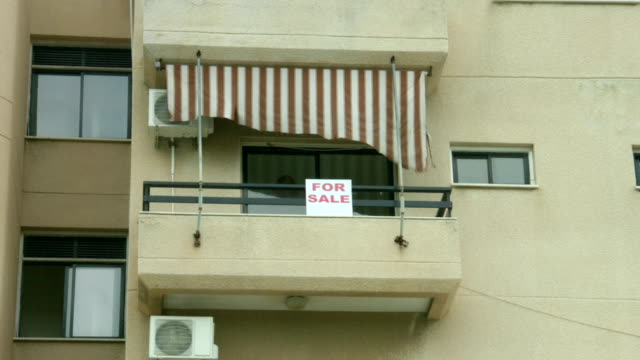 For sale sign on apartment balcony. Real estate agency services. video