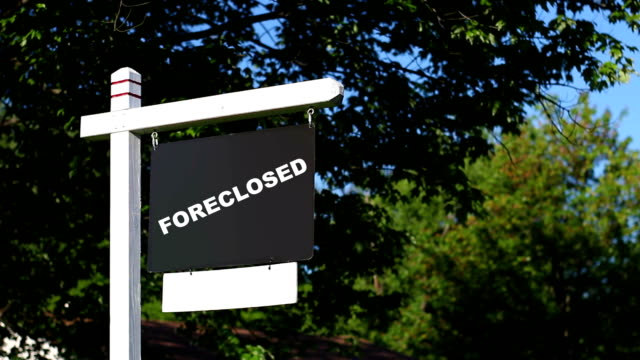 foreclosed real estate sign in front yard infront of property - foreclosure stock videos & royalty-free footage