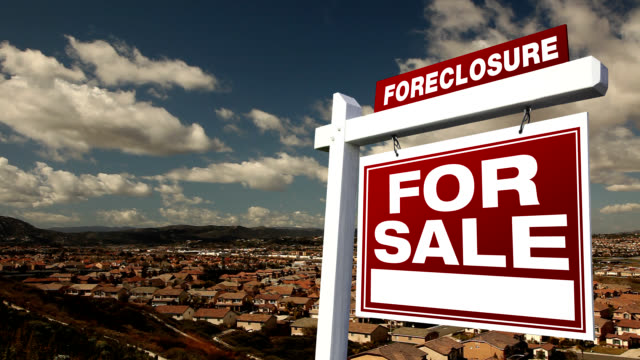foreclosure for sale real estate sign and time-lapse clouds - foreclosure stock videos & royalty-free footage