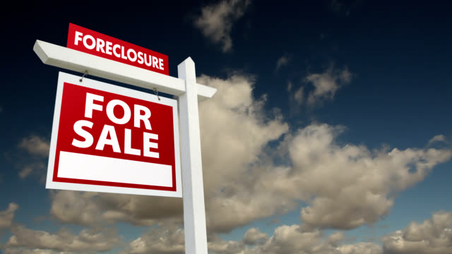 foreclosure home for sale real estate sign with time-lapse clouds - foreclosure stock videos & royalty-free footage