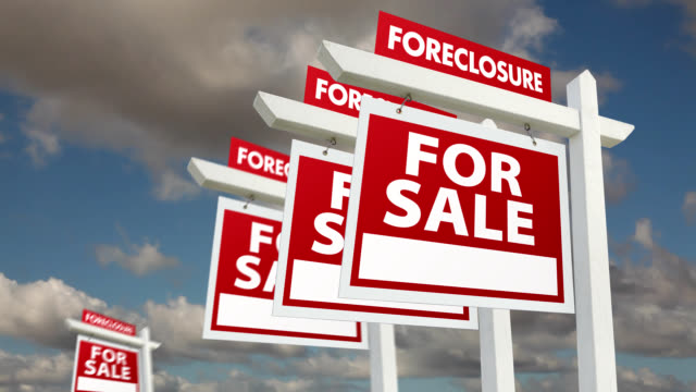 foreclosure real estate signs lining up and clouds - foreclosure stock videos & royalty-free footage