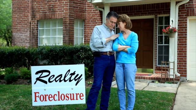 foreclosure sign for bad times - foreclosure stock videos & royalty-free footage