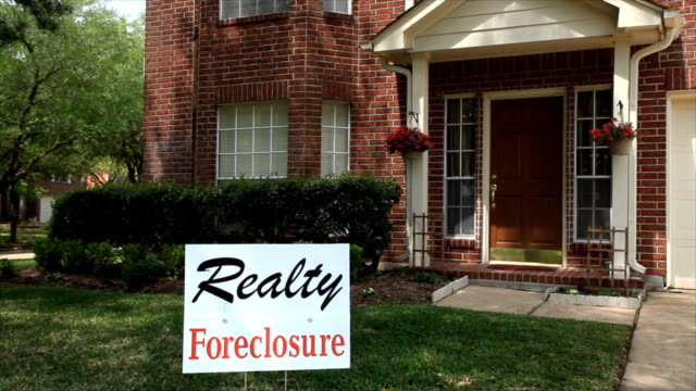 foreclosure sign on house - foreclosure stock videos & royalty-free footage