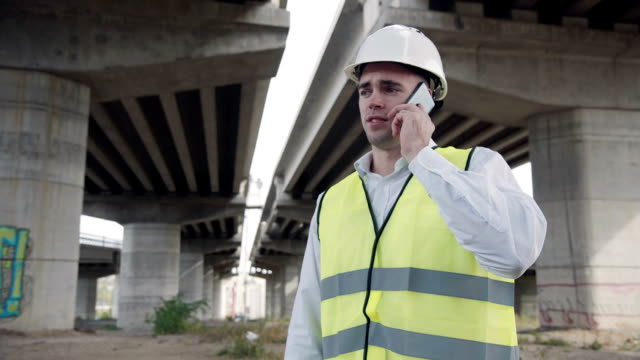 Foreman talking on mobile phone video