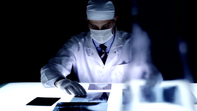Forensic Doctor Finding Cause of Death Dark Room Laboratory video