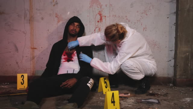 Forensic Investigator Collecting Blood Sample at Crime Scene video