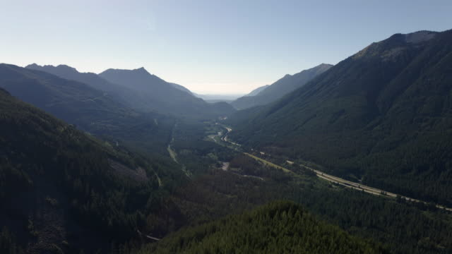 Forest Tree Aerial Reveal of Interstate 90 Freeway in Mountain Valley