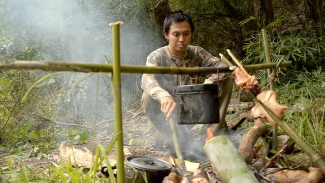 Forester preparing food. video