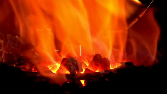 forging a fire for heating metal, slow motion - horseshoe stock videos & royalty-free footage