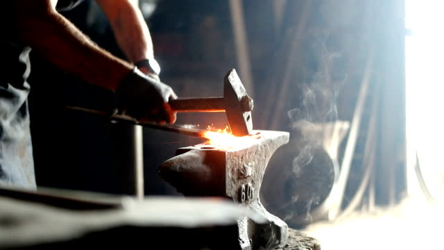Forging hot iron Forging hot iron anvil stock videos & royalty-free footage
