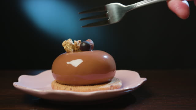 Fork Digging into Dessert on a Plate video