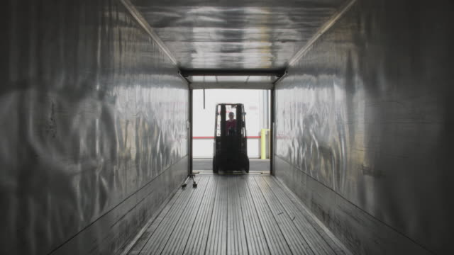 Forklift driving into semi truck trailer. Forklift driving into semi truck trailer.  Fully released for commercial use. forklift stock videos & royalty-free footage