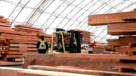 istock Forklift moving timber beams 1179245397