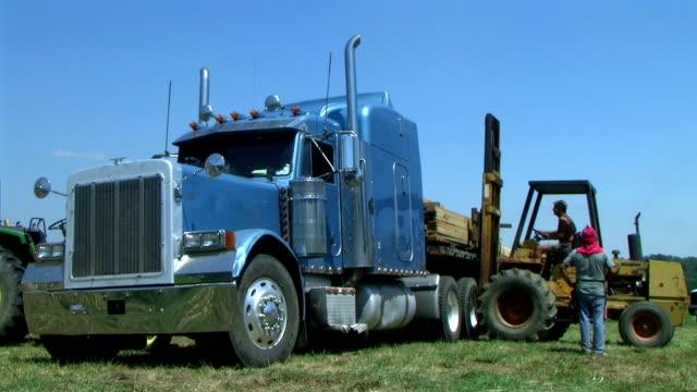 Forklift Unloading Construction Lumber 03 video