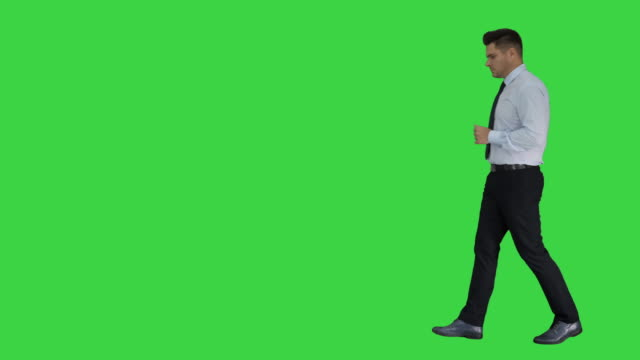 Formal man walks in frame and gets an idea then walks out on a Green Screen, Chroma Key
