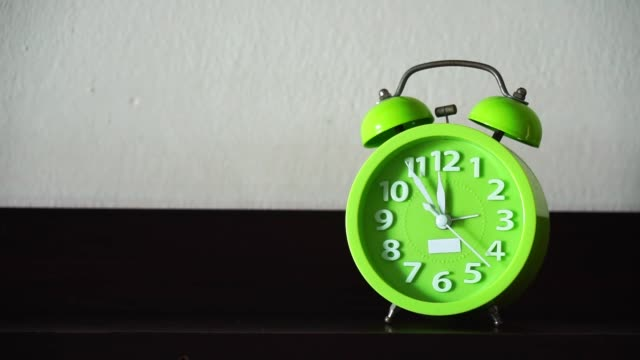 HD format, Time lapse close up green alarm clock.