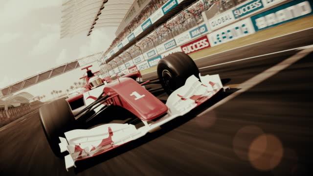 포뮬러 1 경주용 자동차, 결승선을 가로질러 주행 - 복고풍 스타일 - formula 1 스톡 비디오 및 b-롤 화면