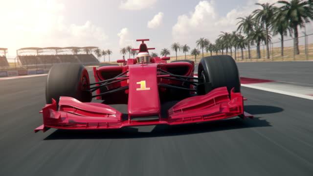 Formula one race car driving across finish line