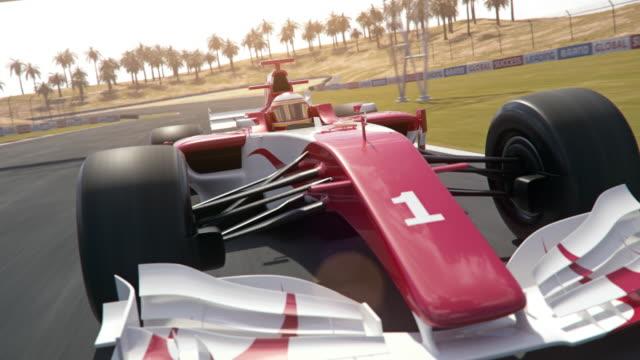 포뮬러 1 경주 용 자동차 경주 트랙을 따라 운전 - 동적 프론트 뷰 남쪽 스트레칭 - formula 1 스톡 비디오 및 b-롤 화면