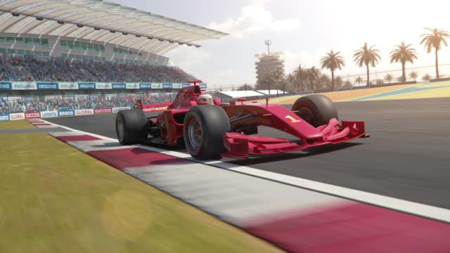 포뮬러 1 경주 용 자동차 운전 과거 카메라 - formula 1 스톡 비디오 및 b-롤 화면