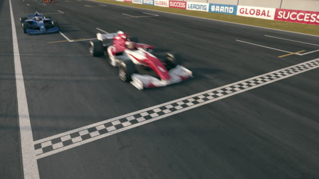 formula one race cars crossing finishing line - static cam