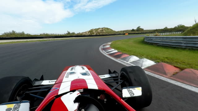 Formula one racing car driving on a racetrack Formula one racing car driving on a racetrack. Its a pov shot of the driver, who is steering. contest stock videos & royalty-free footage