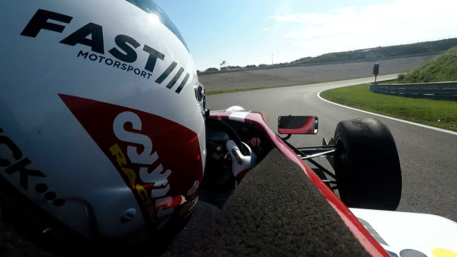 Formula one racing car driving on a racetrack