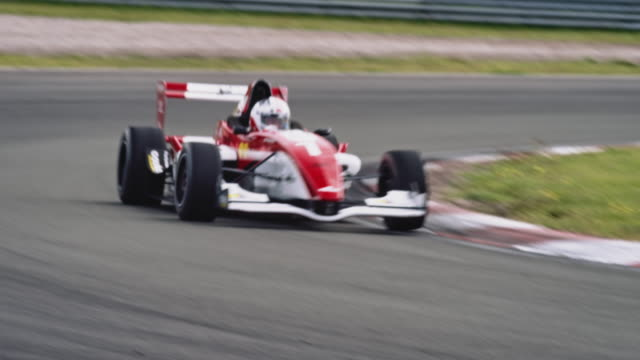 formular one racing car driving on a racetrack - race stock videos & royalty-free footage