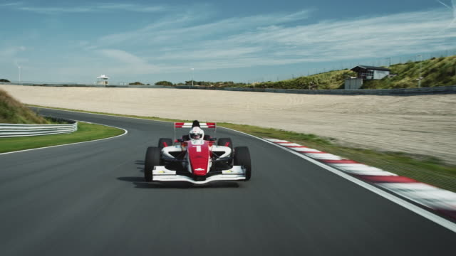 Formular one racing car driving on a racetrack