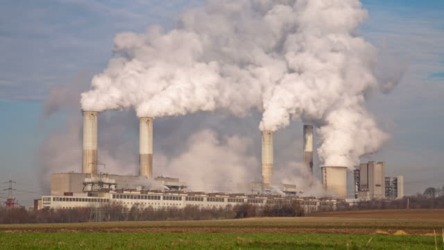 DOLLY TIME LAPSE: Fossil Fuels Dolly Time lapse of a coal fired power station 笹 stock videos & royalty-free footage