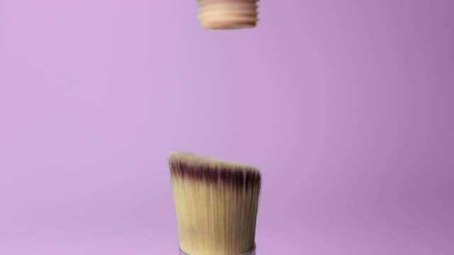 Foundation pouring on make-up brush on pink background. Foundation pouring on make-up brush on pink background. Foundation brush, foundation, skin, shade, camouflage, beauty, makeup, cosmetics foundation make up stock videos & royalty-free footage