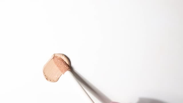 foundation Smears of foundation for face.   Cosmetic smear. Isolated on white background. eyeshadow stock videos & royalty-free footage